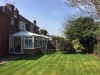 Before - looking across garden to conservatory