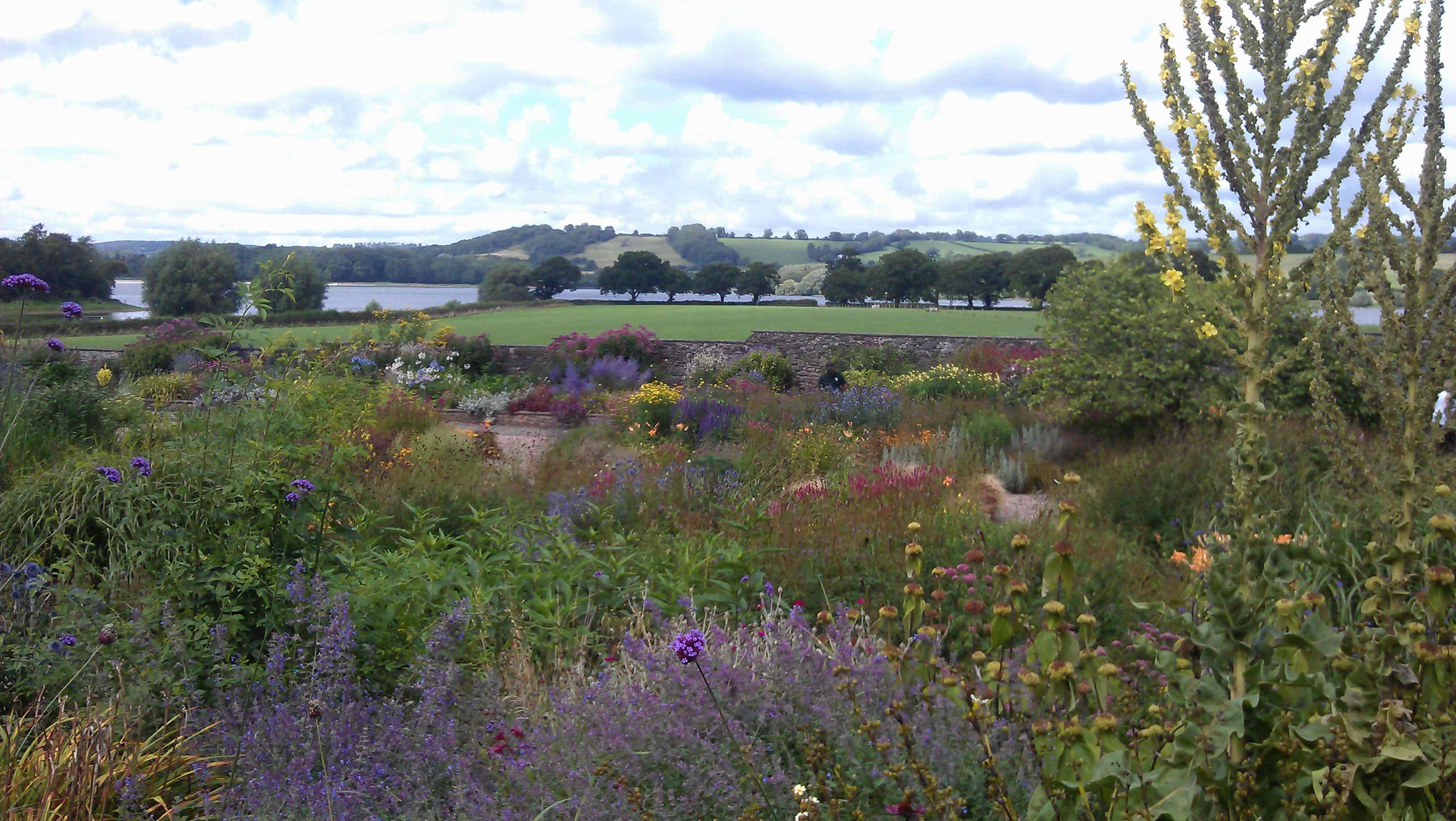 Yeo Valley garden and distant Blagdon lake